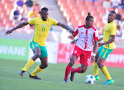 Andriamirado Hasina of Madagascar and Matlhari Makaringe of South Africa during the 2018 COSAFA Cup quarter final match between South Africa and Madagascar at Old Peter Mokaba Stadium on June 03, 2018 in Polokwane, South Africa.