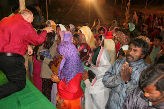 Photo: Ricky praying with the women who responded for the first time for salvation.