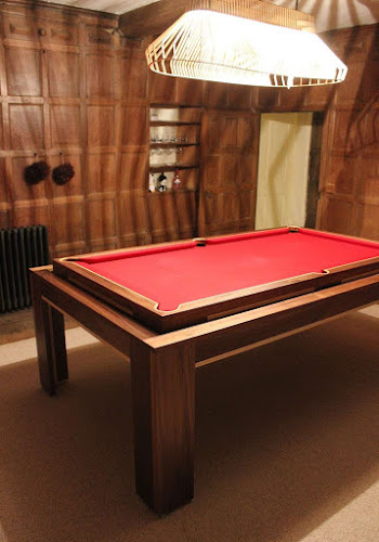 The custom spartan rollover pool table in a loft