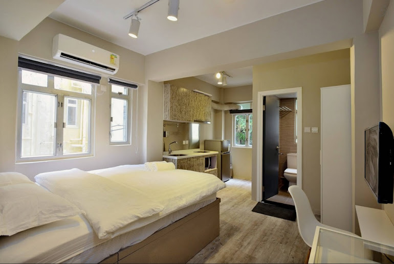 Bedroom at Hollywood Road Serviced Apartments, Central