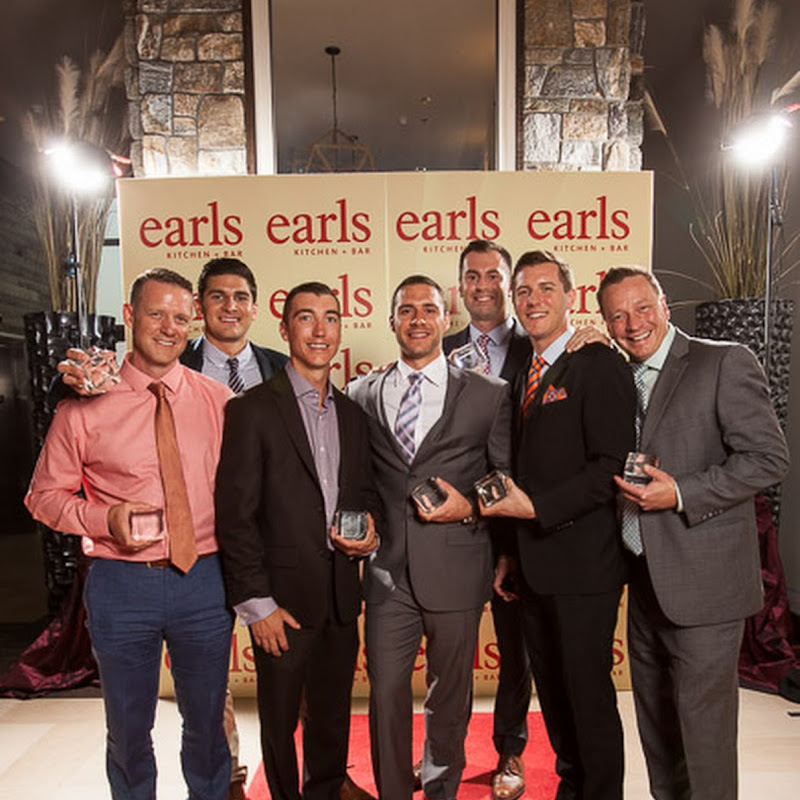 Earls Experience Awards winners holding their awards at the gala in 2014.