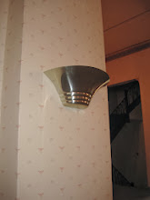 Photo: Wall sconce in lobby.