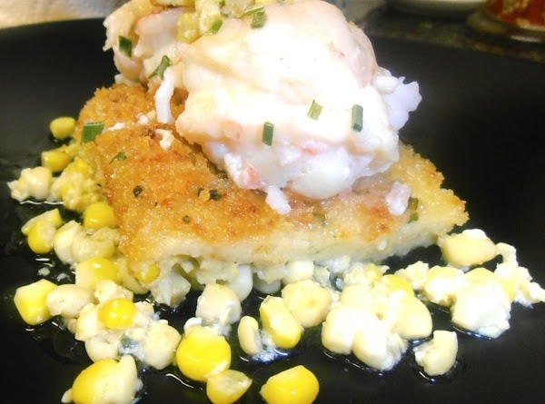 on a plate, add some coconut corn pudding, top with lobster and drizzle with...