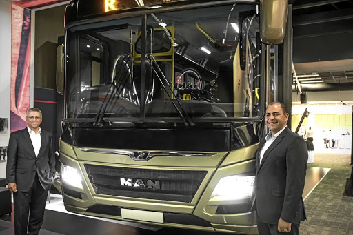 MAN Truck and Bus SA CEO Markus Geyer (left) and Philip Kalil-Zackey, head of MAN Bus and Coach Sales SA, with the new commuter bus.