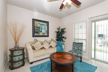 Raleigh model living room with carpet and ceiling fan