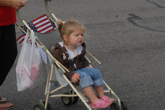 Photo: A child looks at the Patriot Guards flag line.