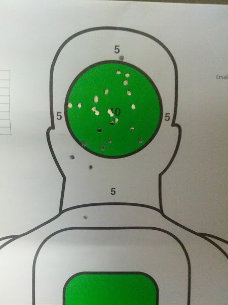 Photo: .22LR conversion on G17 at 21' - the dropped rounds are from the FTE federals.