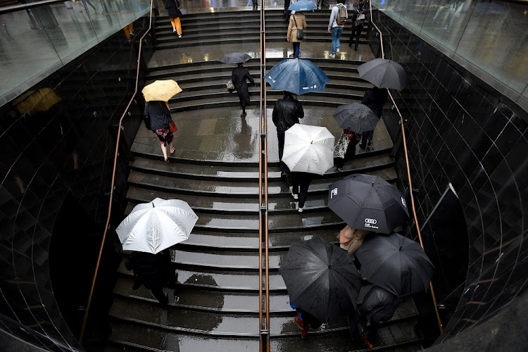 Office workers are seen during wet weather in Sydney, Australia on October 4 2018. Picture: AAP/Mick Tsikas/via REUTERS