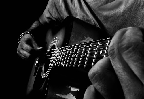 Music- Companion to the soul by Nirmal Neelakandan - Artistic Objects Musical Instruments ( mesmerise, music, freedom, peace, black & white, capture, soul, black and white collection, pain, guitar )
