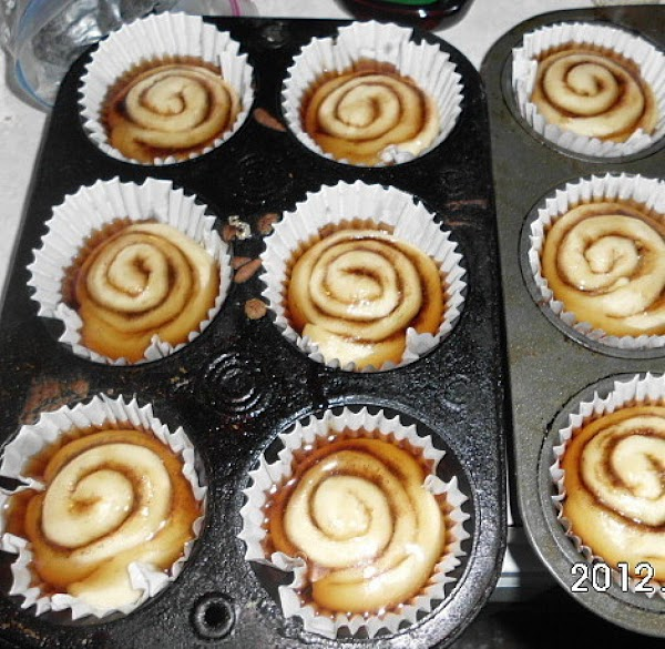 Once rolls have risen, drizzle with maple syrup.