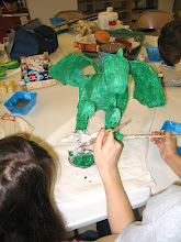 Photo: Students painting their Papier Mache project.