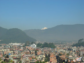 Photo: A hazy morning in Kathmandu and a white Himalayan peak in the background