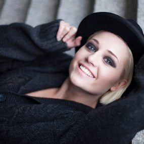 Georgia Wood by Antony Sendall - People Portraits of Women ( fashion, blonde, editorial, gorgeous, beautiful, grey cardigan, steps, trilby, smile, stunning, grey jumper, hat )