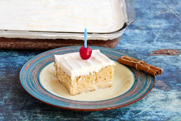 A Slice Of Mom's Tres Leche Cake On A Plate.