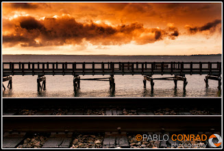 Photo: © Paul Conrad/Pablo Conrad Photography Wet rail tracks reflect the evening light as the setting sun ignites the clouds above the Boardwalk at Boulevard Park in Bellingham, Wash., on Oct. 28, 2011.
