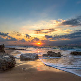 As Sunset dips into the sea by Sergio Gold - Landscapes Sunsets & Sunrises