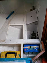 Photo: Looking aft at new quarterberth lockers.  Note cleats and strap the keep starter battery secured.