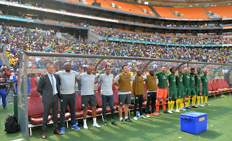 The Bafana Bafana bench during the singing of the national anthems before kickoff of their 2019 Africa Cup of Nations qualifier between South Africa and Nigeria at FNB Stadium in Soweto, south west of Johannesburg, on November 17 2018.