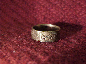 Photo: A test cast in bronze of a wedding ring based on elements of the 9th century Anglo-Saxon Polingsford ring with a personalised dedication. The final version was cast in gold and was 22mm in diameter.