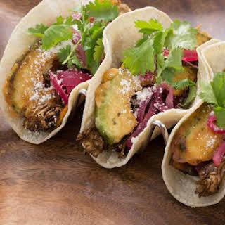 Mixed Mushroom Tacos with Crispy Avocado & Cotija Cheese.