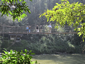 Photo: The rest of the group follows on the suspension bridge.