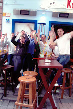 Photo: The rain didn't seem to bother this group of students, enjoying plenty of beer at one of the local bars.