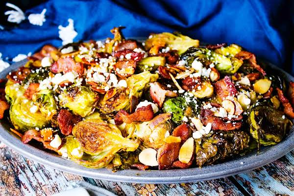 A Large Platter Of Bacon Bleu Brussels Sprouts With Mustard Sauce.