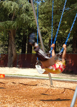 Photo: Requirement 2 (foreground blur): The kid puts forth a herculean effort to start swinging -- and he does! Slow shutter speed (1/25) captures the action, blurred.