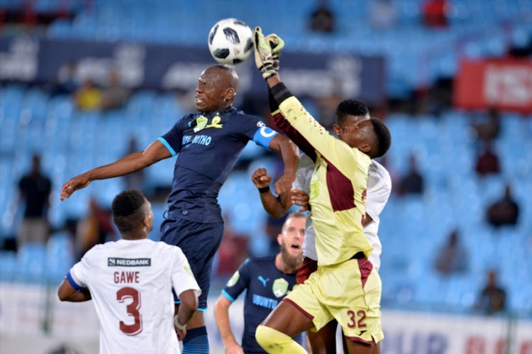 Hlompho Kekana of Mamelodi Sundowns and Khanya Mini of EC Bees during the Nedbank Cup, Last 16 match between Mamelodi Sundowns and EC Bees at Loftus Stadium on March 13, 2018 in Pretoria.
