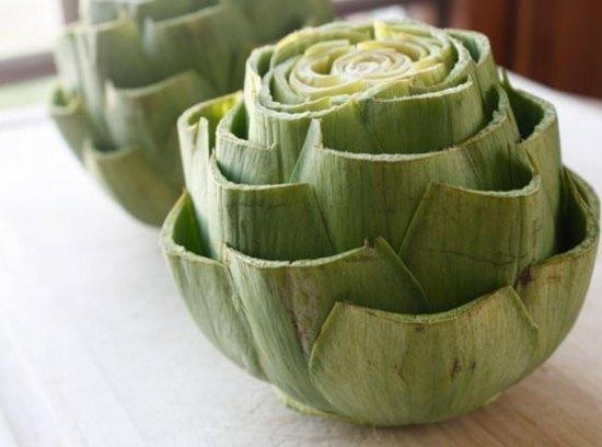 Cut off the top inch of the artichoke and trim the pointed leaves. Cut...