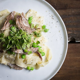Pappardelle with Braised Duck, Fresh Peas, and Spiced Goat Cheese Sauce
