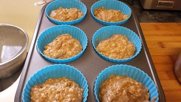 Mash bananas in a large mixing bowl. Stir in applesauce, egg, brown sugar, and...