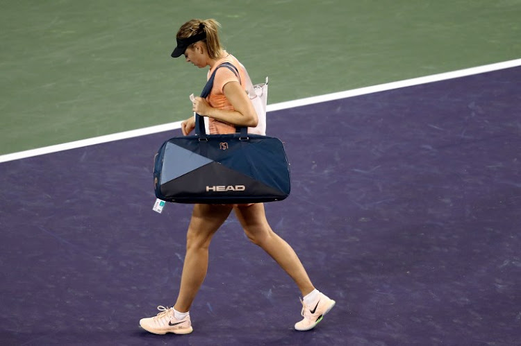 Maria Sharapova of Russia leaves the court after losing to Naomi Osaka of Japan during the BNP Paribas Open at the Indian Wells Tennis Garden on March 7, 2018 in Indian Wells, California.