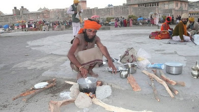 Photo: We sat down after an invitation from the sadhus outside the Somnath temple in South Gujarat. We had someone with us that spoke Gujarati and Hindi which made communicated easier. These guys just wandered from spiritual site to site in an orderly pilgrimage way. Somnath Temple, Veraval Gujarat  STREET FOOD The Staple Of India & Sri Lanka 10 Video Minute Montage http://www.youtube.com/user/Sufibooks#p/a/u/0/iobh2V1Rq6Q