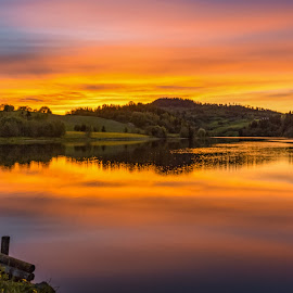 Sunset by the river by Grete Øiamo - Landscapes Sunsets & Sunrises ( water, orange, sunset, yellow, evening, river )