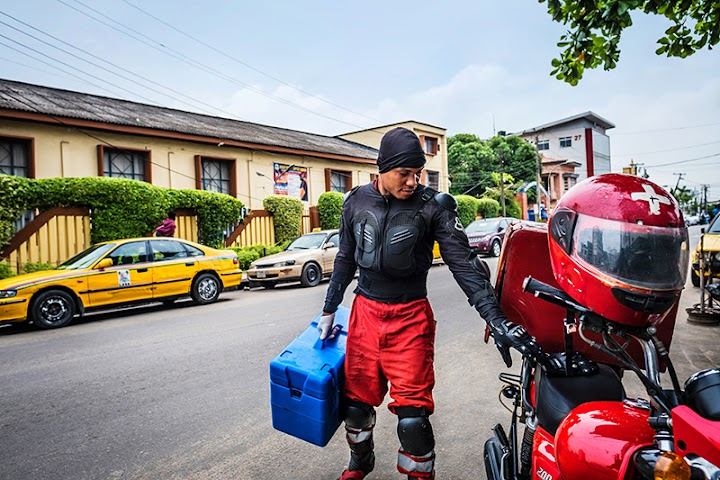 Joseph Kalu, a LifeBank driver, carrying blood is in his cold chain transport box.