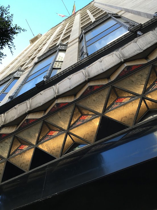 Looking up at the Oviatt Building facade.