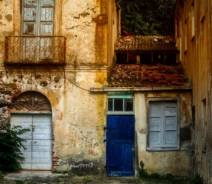 Blue and pale blue door by Antonello Madau - City,  Street & Park  Historic Districts