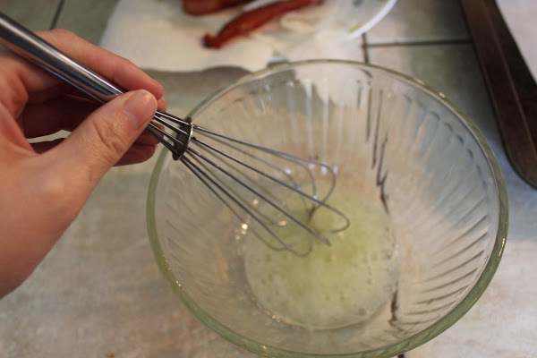 In a small bowl, whisk egg white until frothy.