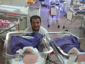 Photo: Aharon and his two almost day old daughters.