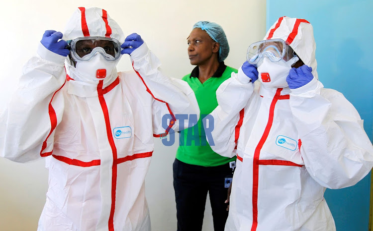Nurses wear protective gear during a demonstration of preparations for coronavirus cases at the Mbagathi Hospital isolation centre.