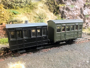 Photo: 011 A closer view of the new Peco Glyn Valley coach posed alongside the Parkside Dundas version, which most modellers know is based on rather than a scale model of a GVT coach. The difference in sizes is very apparent .