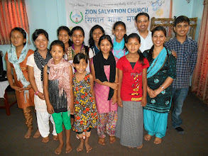 Photo: In Nepal they have their Holy day on Saturday. Merle ministered in Pastor Anand's church. Pastor Anandis on the far right with his wife Pricilla in front of him and their son Aaron on thefar right. The other girls areall his orphan children in their orphan home. Pastor Anand was also our MTM conference coordinator. MTM has been working with Pastor Anand now for several years in several projects. We have learned to greatly appreciate him as a sincere servant of our Lord and count it a great privilege and honor to partner with him.