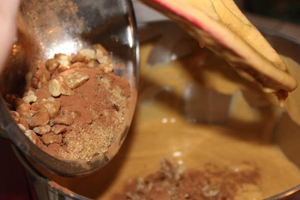 Add cinnamon, 1 cup walnuts & brown sugar, mixing well.