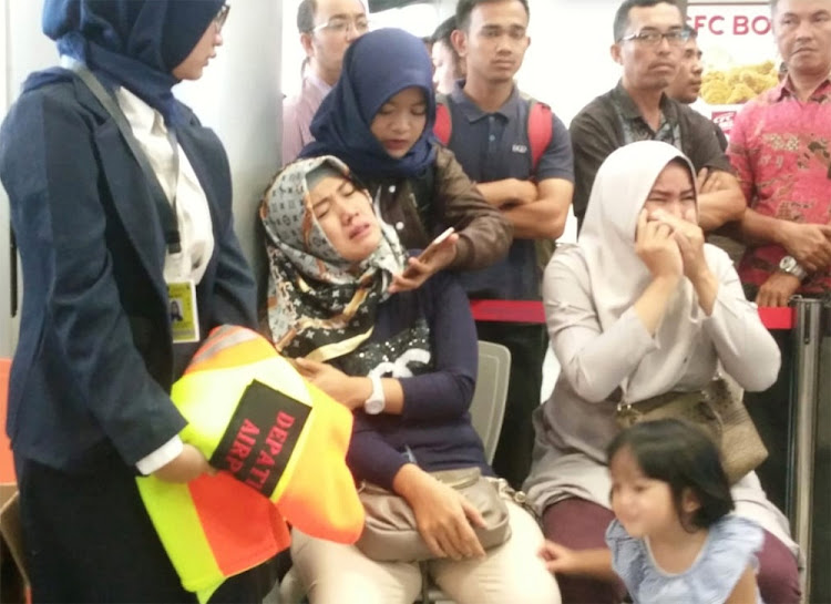 Relatives of passengers on the Lion Air flight JT610 that crashed into the sea at Depati Amir airport in Pangkal Pinang, Indonesia on October 29 2018. Picture: Antara Foto/Elza Elvia via REUTERS
