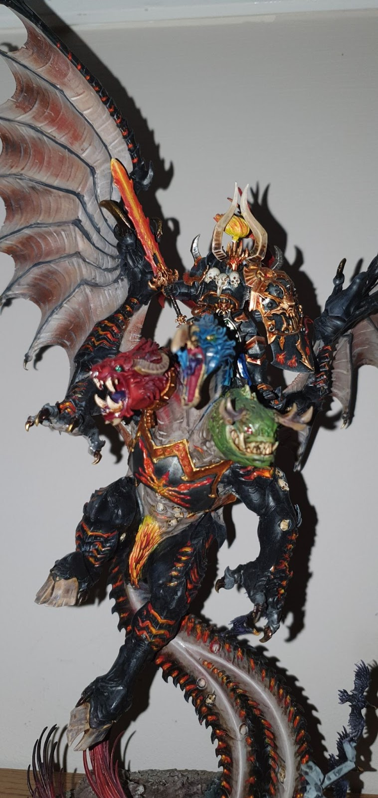 Archeon the Everchosen model.  Painted black and flesh coloured with glowing red to orange runes and flame effects.