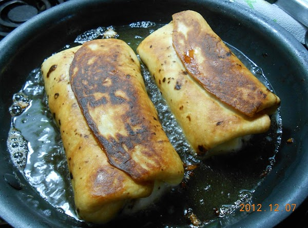 "In med. skillet, add about 1-2"" of canola oil over med. high heat. ..."