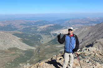 Photo: R. is counting the peaks we ascend. #1 is Democrat. We forgot to bring Obama's photo. Sorry Cat!