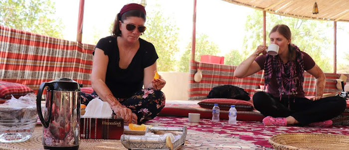 Drinking and Eating in a traditional style in Oman - Two Women Travelers | Krys Kolumbus Travel