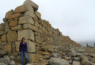 Photo: Taking a break from surface survey collections to pose with a large wall at the Formative Period (1800-200BC) site of Kushipampa, located in the Nepeña valley.